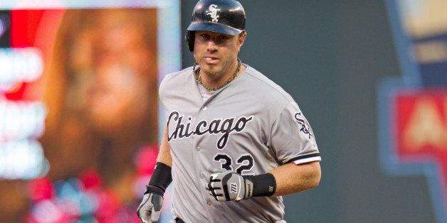 MINNEAPOLIS, MN - AUGUST 16: Adam Dunn #32 of the Chicago White Sox rounds the bases after hitting a home run against the Min