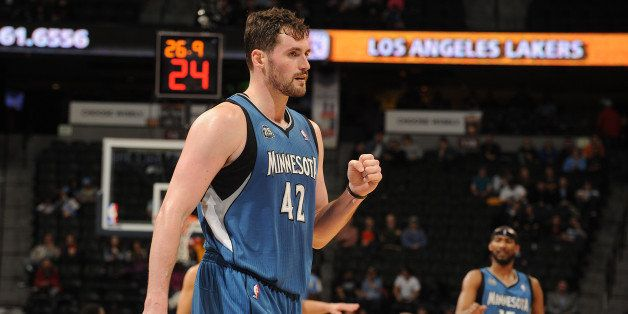 DENVER, CO - March 3: Kevin Love #42 of the Minnesota Timberwolves celebrates during the game against the Denver Nuggets on M
