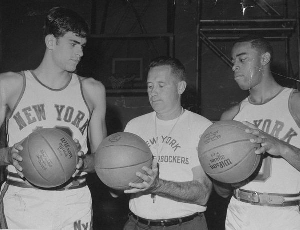 New York Knicks' Phil Jackson, coach Dick McGuire and Walt Frazier (l.-r.) during practice at McGuire Air force Base. (Photo