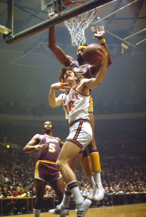 Wilt Chamberlain #13 of the Los Angeles Lakers attempts to block the shot of Phil Jackson #18 of the New York Knicks during a