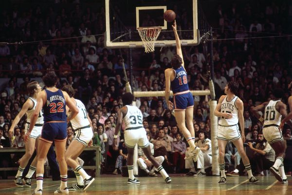 Phil Jackson #18 of the New York Knicks shoots a layup against the Boston Celtics during a game played in 1974 at the Boston