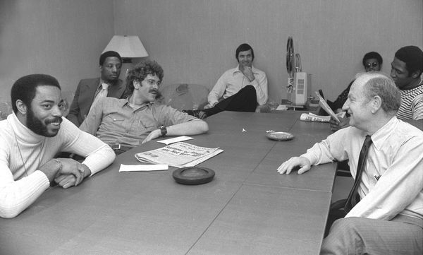 A relaxed bunch of Knicks sit around projector with their director, Red Holzman (right), at Madison Square Garden where they'
