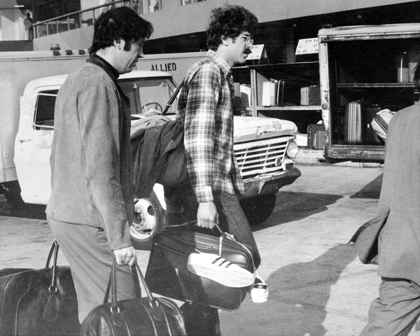 Bill Bradley and Phil Jackson aren't too big to carry their own luggage at Kennedy Airport after returning from Los Angeles w