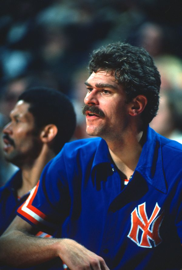 Phil Jackson #18 of the New York Knicks looks on from the bench against the Washington Bullets during an NBA basketball game