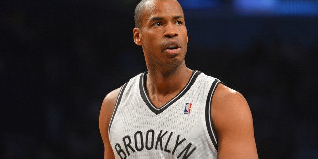 BROOKLYN, NY - MARCH 10: Jason Collins #98 of the Brooklyn Nets during a game against the Toronto Raptors on March 10, 2014 a