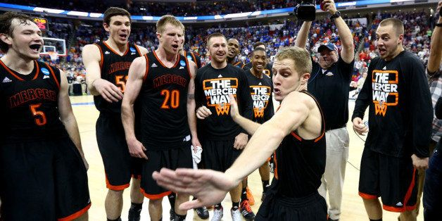 RALEIGH, NC - MARCH 21:  Kevin Canevari #3 of the Mercer Bears celebrates with teammates after defeating the Duke Blue Devils