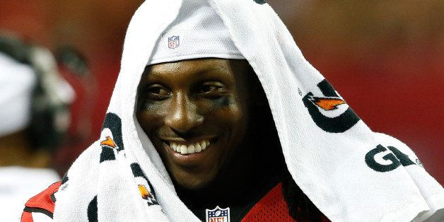 ATLANTA, GA - AUGUST 08:  Roddy White #84 of the Atlanta Falcons enjoys a laugh on the sidelines during the game against the