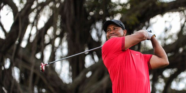DORAL, FL - MARCH 9:  Tiger Woods tees off on the fifth hole during the final round of the World Golf Championships-Cadillac