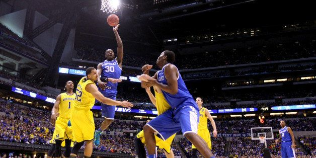 INDIANAPOLIS, IN - MARCH 30:  Julius Randle #30 of the Kentucky Wildcats shoots the ball over Jordan Morgan #52 of the Michig