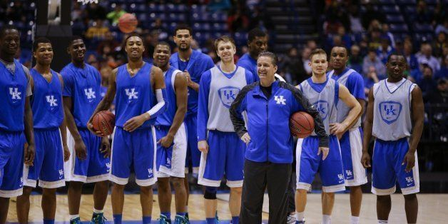 Kentucky Wildcats head coach John Calipari talks to his team as Kentucky practiced at Lucas Oil Stadium on Thursday March 27,