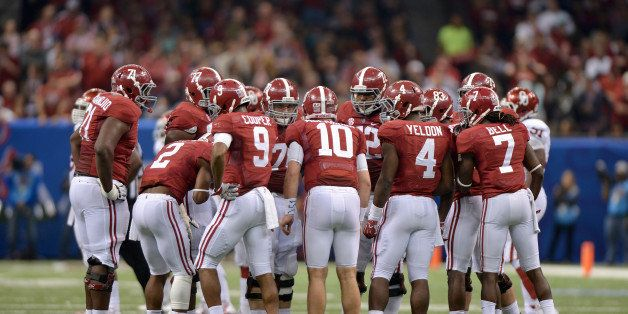 NEW ORLEANS, LA - JANUARY 2: Quarterback AJ McCarron #10 of the Alabama Crimson Tide commands a huddle during second half act