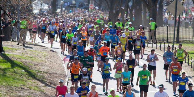 BOSTON, MA - APRIL 21: Runners head down Commonwealth Avenue toward the finish line during the 118th running of the Boston Ma