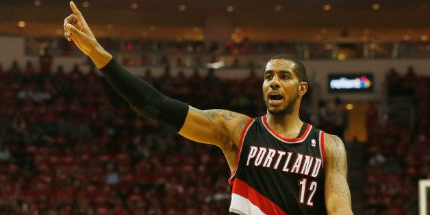 HOUSTON, TX - APRIL 23:  LaMarcus Aldridge #12 of the Portland Trail Blazers celebrates a play on the court in the second hal