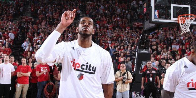 PORTLAND, OR - APRIL 25: LaMarcus Aldridge #12 of the Portland Trail Blazers stands for the National Anthem before a game aga