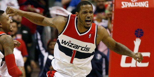 WASHINGTON, DC - APRIL 27:  Trevor Ariza #1 of the Washington Wizards celebrates after scoring a key basket late in the fourt