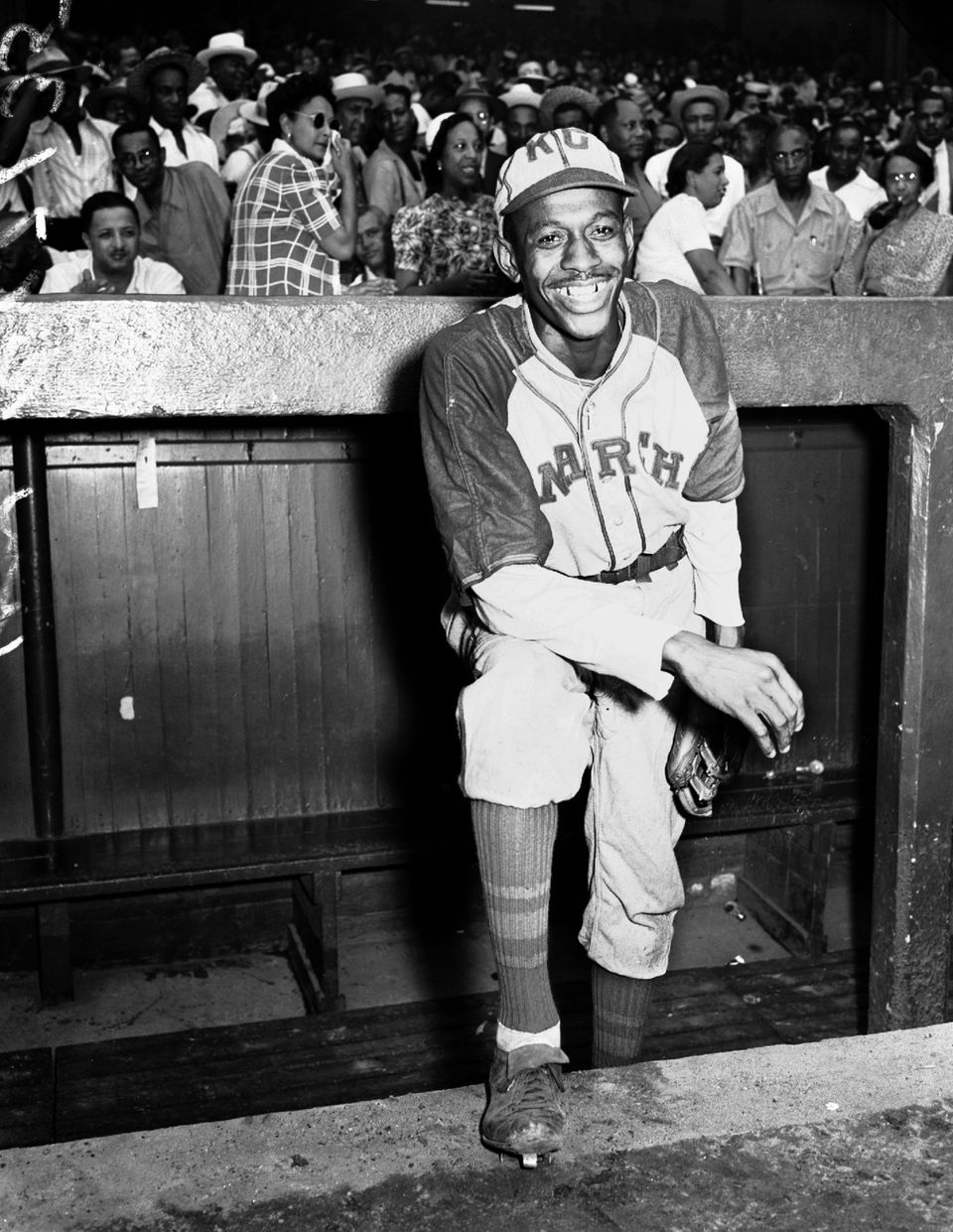 Kansas City Monarchs pitching great Leroy Satchel Paige poses in the dugout at New York's Yankee Stadium August 2, 1942 for a