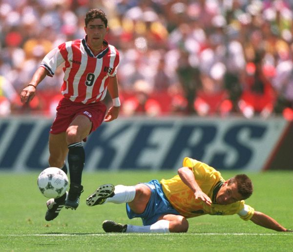 4 JUL 1994:  TAB RAMOS OF THE USA AVOIDS THE TACKLE OF DUNGA OF BRAZIL DURING THE FIRST-HALF OF THE 1994 WORLD CUP MATCH AT S