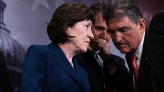 WASHINGTON, DC - FEBRUARY 15:  U.S. Sen. Susan Collins (R-ME) (L) talks to Sen. Joe Manchin (D-WV) (R) as Sen. Jeff Flake (R-AZ) (C) looks on during a news conference February 15, 2018 at the Capitol in Washington, DC. The so-called ÔCommon Sense CoalitionÕ that is working on immigration legislation held a news conference to discuss the upcoming votes on immigration.  (Photo by Alex Wong/Getty Images)