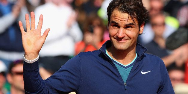MONTE-CARLO, MONACO - APRIL 20:  Roger Federer of Switzerland thanks the support after losing to Stanislas Wawrinka of Switze