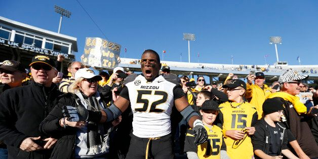 LEXINGTON, KY - NOVEMBER 9: Michael Sam #52 of the Missouri Tigers celebrates with fans after the game against the Kentucky W