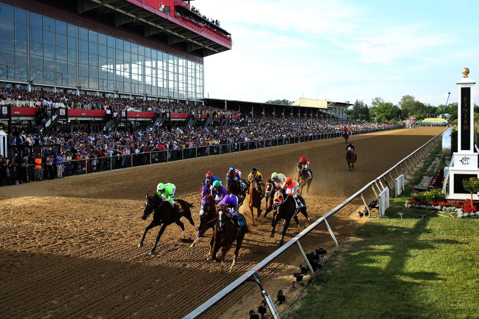 BALTIMORE, MD - MAY 17:  The field races into the first turn during the 139th running of the Preakness Stakes at Pimlico Race