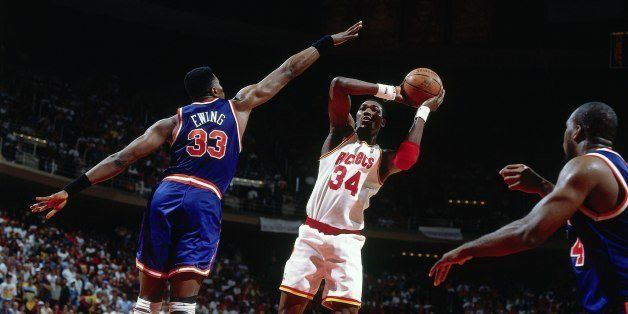 HOUSTON - JUNE 19:  Hakeem Olajuwon #34 of the Houston Rockets shoots against Patrick Ewing #33 of the New York Knicks in Gam