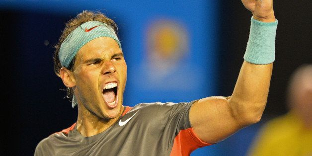 Spain's Rafael Nadal celebrates his victory against Switzerland's Roger Federer during their men's singles semi-final match o