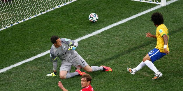 SAO PAULO, BRAZIL - JUNE 12: Julio Cesar (L) and Marcelo of Brazil watch as a deflected shot goes in during the 2014 FIFA Wor