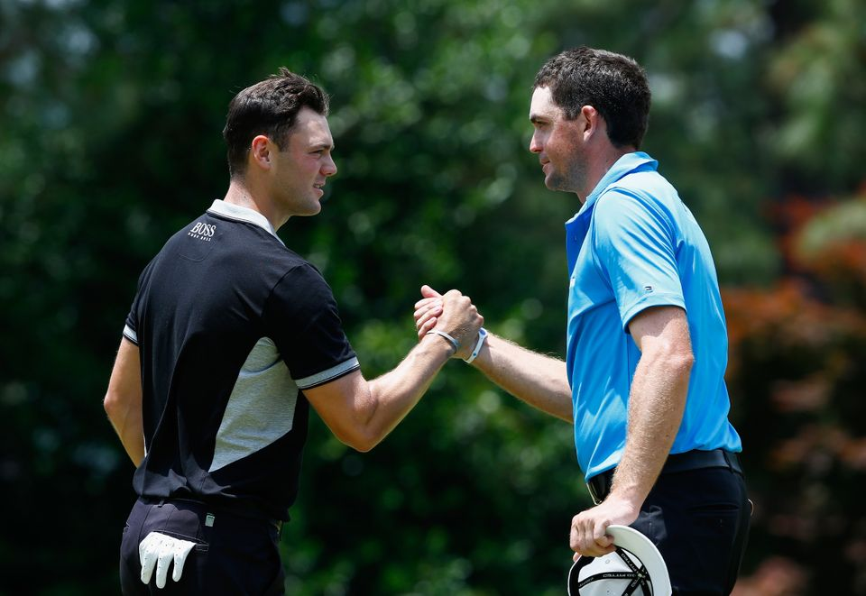 PINEHURST, NC - JUNE 13:  Martin Kaymer of Germany (L) shakes hands with Keegan Bradley of the United States on the ninth gre