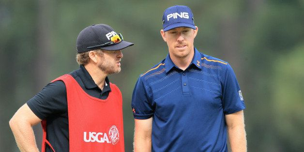 PINEHURST, NC - JUNE 13:  Hunter Mahan of the United States waits on the 12th green with his caddie John Wood during the seco