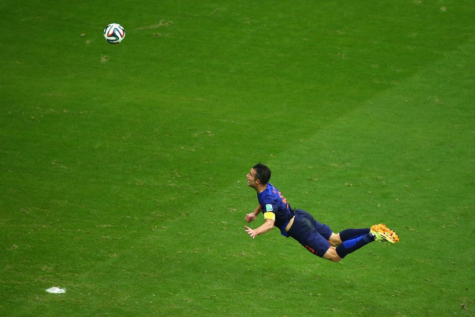 SALVADOR, BRAZIL - JUNE 13: Robin van Persie of the Netherlands scores the teams first goal with a diving header in the first