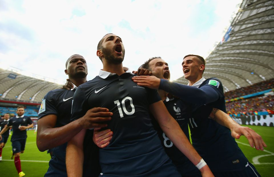 PORTO ALEGRE, BRAZIL - JUNE 15: Karim Benzema of France (2nd L) celebrates with teammates after scoring his team's first goal