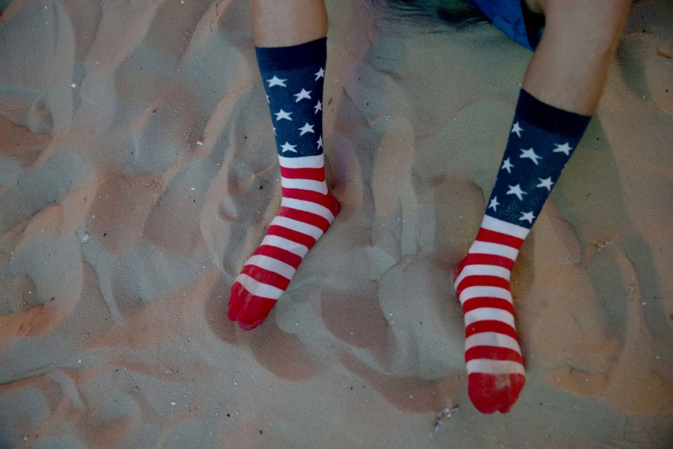 American soccer fan wears his American flag socks as he waits for his team to play against Ghana at the FIFA World Cup Fan Fe