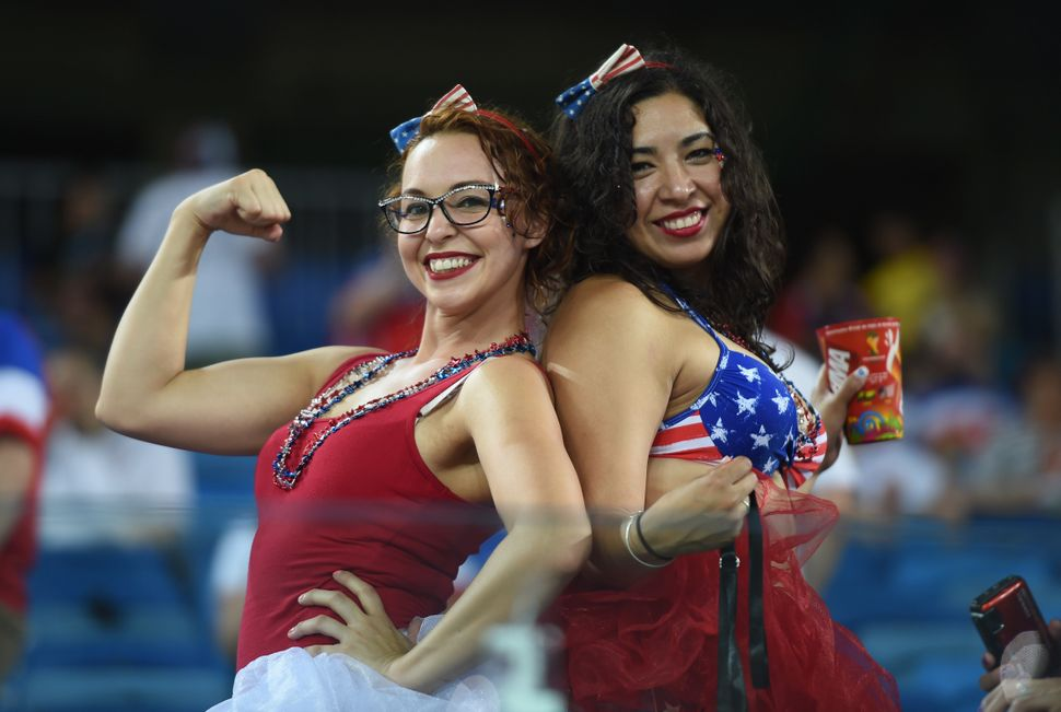 US fans cheer before a Group G football match between Ghana and US at the Dunas Arena in Natal during the 2014 FIFA World Cup