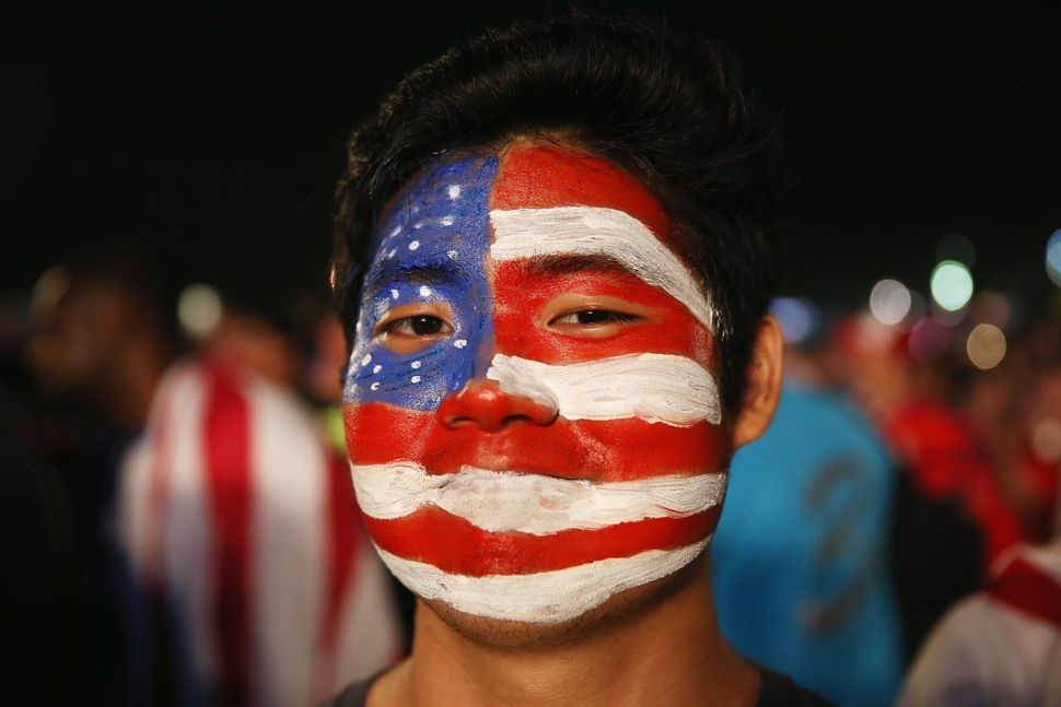 An American soccer fan waits for his team to play against Ghana at the FIFA World Cup Fan Fest on Copacabana beach on June 16