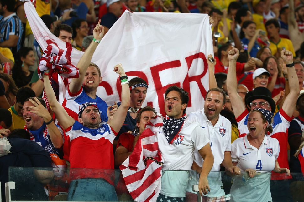 Fans of the United States cheer during the 2014 FIFA World Cup Brazil Group G match between Ghana and the United States at Es