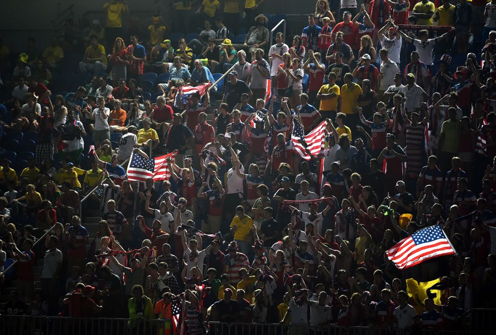 Fans of  the United States cheer during the 2014 FIFA World Cup Brazil Group G match between Ghana and the United States at E