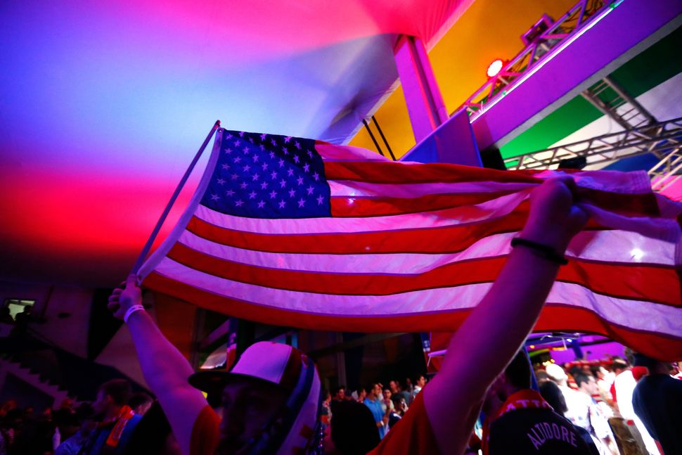 US soccer fans attend the FIFA Fan Fest in Natal at Fan HQ on June 15, 2014 in Natal, Brazil.  (Photo by Kevin C. Cox/Getty I