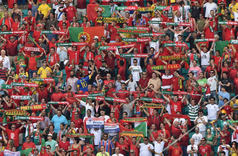Portugal fans pose prior to the Group G football match between Germany and Portugal at the Fonte Nova Arena in Salvador durin