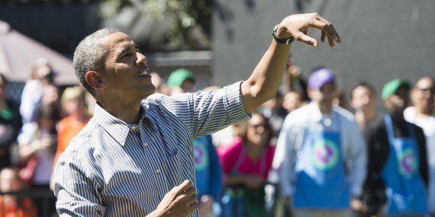 US President Barack Obama follows through after shooting a basketball during the annual White House Easter Egg Roll on the So