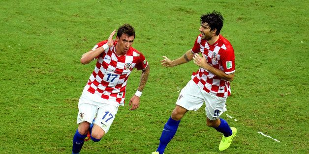 MANAUS, BRAZIL - JUNE 18:  Mario Mandzukic of Croatia celebrates scoring his team's third goal during the 2014 FIFA World Cup