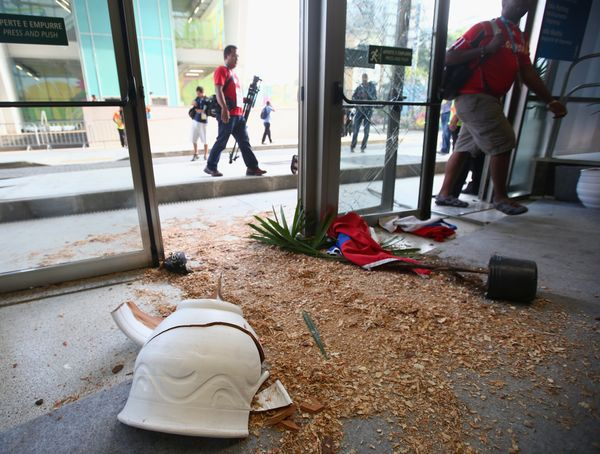 RIO DE JANEIRO, BRAZIL - JUNE 18:  Broken doors and planters are seen after fans broke through security entering the stadium