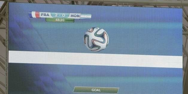 A giant screen in the stadium gives a goal using the new goal line technology during a Group E football match between France