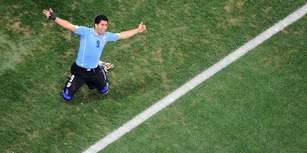 Uruguay's forward Luis Suarez celebrates his second goal during the Group D football match between Uruguay and England at the