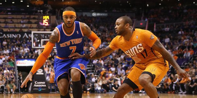 PHOENIX, AZ - MARCH 28:  Carmelo Anthony #7 of the New York Knicks handles the ball under pressure from P.J. Tucker #17 of th
