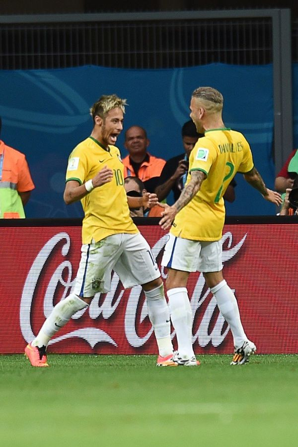 Brazil's forward Neymar (L) celebrates with his teammate Brazil's defender Dani Alves after scoring his second goal during th