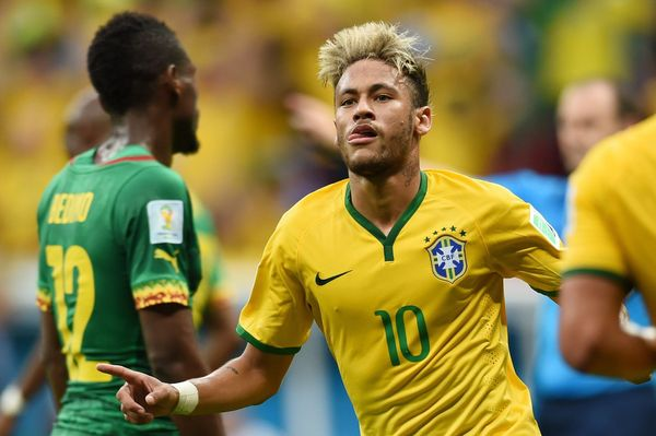 Brazil's forward Neymar celebrates after scoring a second goal during a Group A football match between Cameroon and Brazil at