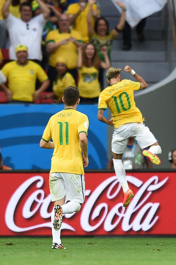 Brazil's forward Neymar (R) celebrates after scoring his second goal during the Group A football match between Cameroon and B