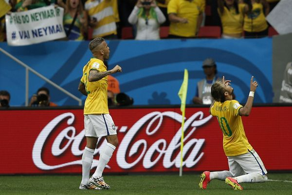 Brazil's forward Neymar (R) celebrate with his teammate defender Dani Alves after scoring a goal during the Group A football