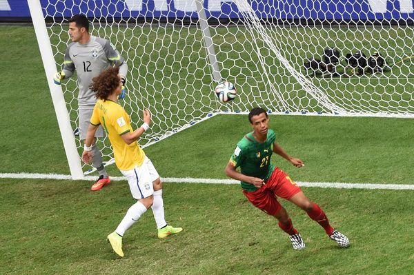 Cameroon's midfielder Joel Matip (R) celebrates after scoring a goal as Brazil's defender David Luiz (C) and Brazil's goalkee